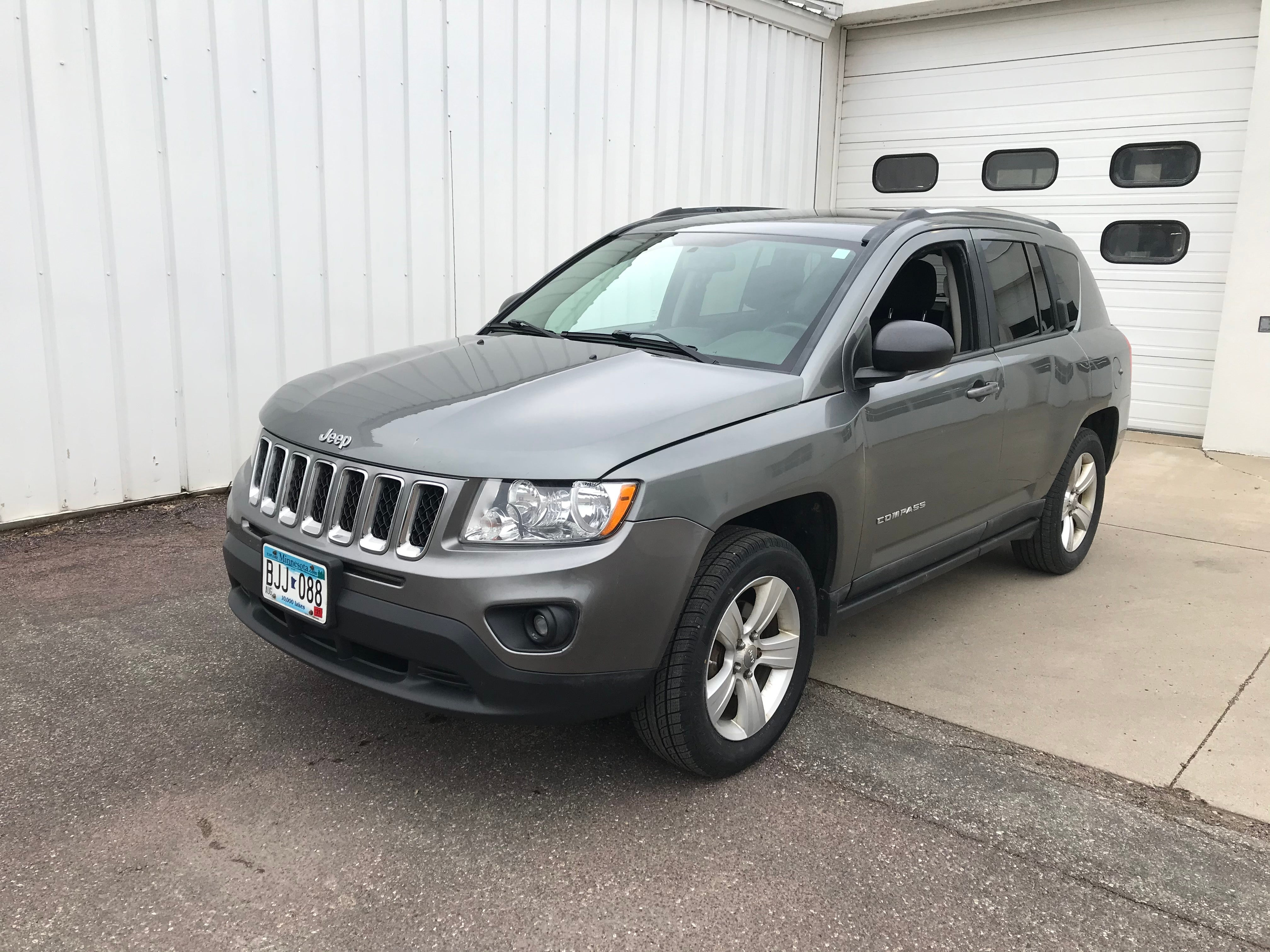 Used 2011 Jeep Compass Latitude with VIN 1J4NF1FB4BD263813 for sale in Arlington, Minnesota
